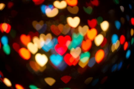 abstract heart shaped bokeh of multi colored christmas lights stock photo 24587691