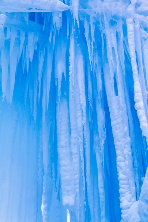 Abstract ice and icicles formations hanging on cold winter day