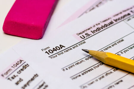 Close up of tax form 1040A with pencil and pink eraser photo