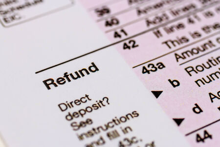 Close up of word Refund on tax form