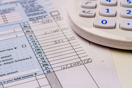 filled out: Close up of numbers on filled out tax form 1040