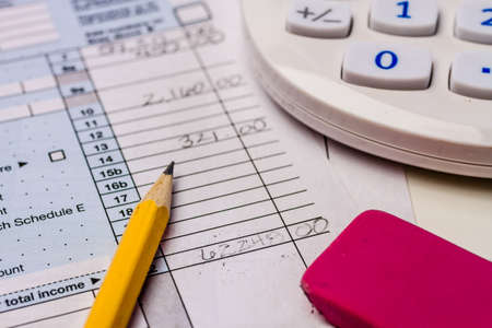 erased: Close up of erased numbers on tax form 1040 Stock Photo