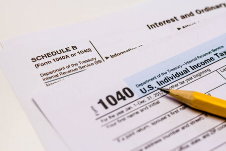 Close up of tax form Schedule B for interest and ordinary dividends with pencil and pink eraser Stock Photo - 26614035