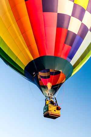 hot springs: Multi-colored hot air balloon taking off at balloon festival Editorial