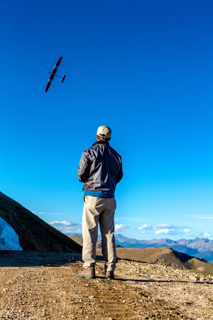 colorado rocky mountains: JONES PASS-EMPIREPARSHALL, COLORADOU.S.A. – September 7, 2014: Model airplane and drone testing on the top of the Continental Divide at Jones Pass wilderness area in the Colorado Rocky Mountains on September 7, 2014 in EmpireParshall, Colorado
