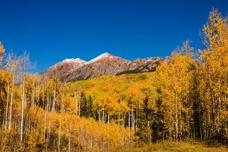 Freshly fallen snow on mountains along Kebler Pass near Crested Butte Colorado on sunny fall morning Stock Photo
