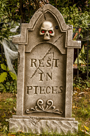 goblins: Creepy Halloween skeleton gravestone with rest in pieces message on front