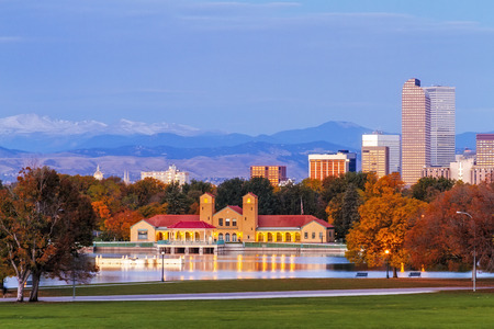 city of denver: Denver Colorado skyline from City Park with City Park Boathouse and Rocky Mountains in background on autumn morning