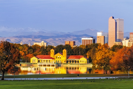 cash register building: Denver Colorado skyline from City Park with City Park Boathouse and Rocky Mountains in background on autumn morning