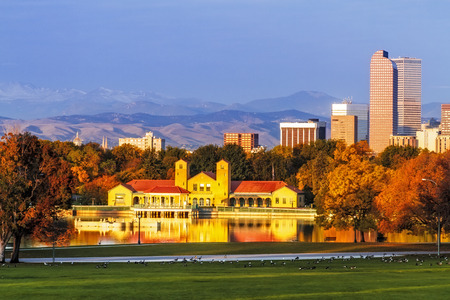 Denver Colorado skyline from City Park with City Park Boathouse and Rocky Mountains in background on autumn morning photo