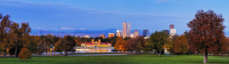 denver history museum: Panorama of Denver Colorado skyline from City Park with City Park Boathouse and Rocky Mountains in background on autumn morning Stock Photo