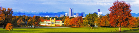 denver skyline with mountains: Panorama of Denver Colorado skyline from City Park with City Park Boathouse and Rocky Mountains in background on autumn morning Stock Photo