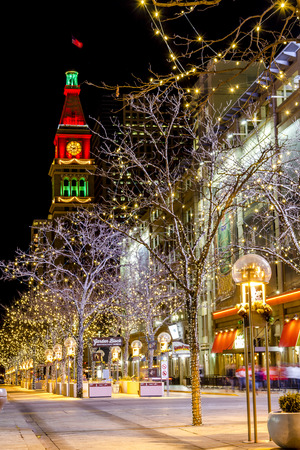 DENVER COLORADO  U.S.A. - December 7, 2014: Holiday light display along Denvers 16th Street Mall with historic landmark the Daniel Fisher Tower in distance with red and green lights on December 8, 2014 in Denver, Colorado Editorial