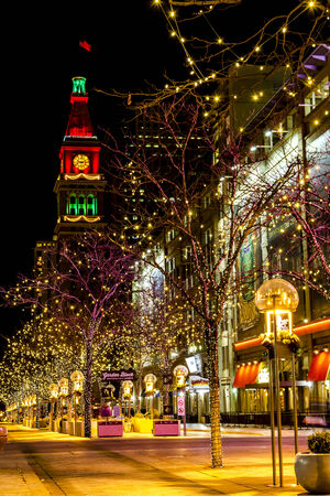 christmas in denver: DENVER COLORADO  U.S.A. - December 7, 2014: Holiday light display along Denvers 16th Street Mall with historic landmark the Daniel Fisher Tower in distance with red and green lights on December 8, 2014 in Denver, Colorado Editorial