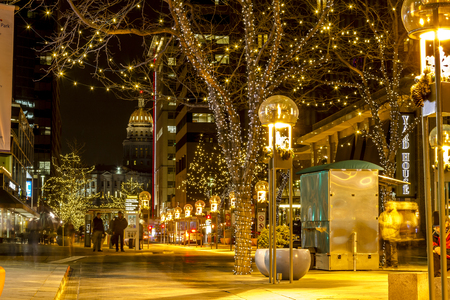 DENVER COLORADO  USA - December 18, 2014: Holiday light display along Denvers 16th Street Mall with Colorado State Capitol Building in distance December 18, 2014 in Denver, Colorado