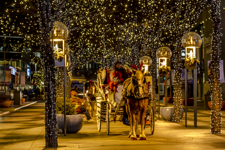 DENVER COLORADO  USA - December 18, 2014: Holiday light display along Denvers 16th Street Mall with horse drawn carriage  December 18, 2014 in Denver, Colorado