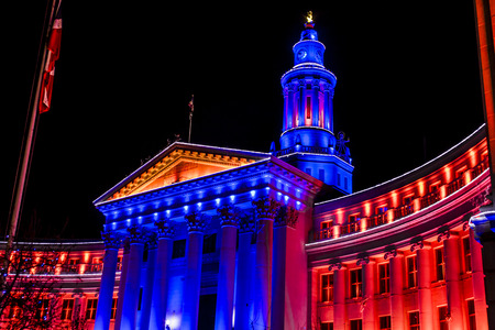 DENVER COLORADO  USA - January 10, 2015, Special light display of Denver City and County Building in Denver Broncos orange and blue for the 2015 NFL Playoffs January 10, 2015 in Denver, Colorado