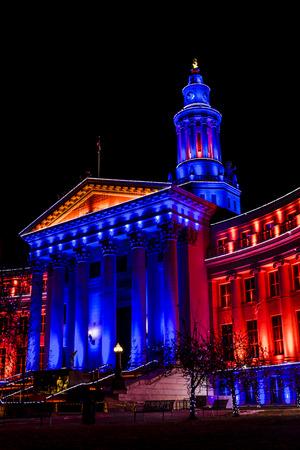 denver colorado: DENVER COLORADO  USA - January 10, 2015, Special light display of Denver City and County Building in Denver Broncos orange and blue for the 2015 NFL Playoffs January 10, 2015 in Denver, Colorado