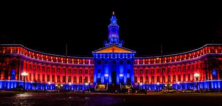 denver co: DENVER COLORADO  USA - January 10, 2015, Special light display of Denver City and County Building in Denver Broncos orange and blue for the 2015 NFL Playoffs January 10, 2015 in Denver, Colorado