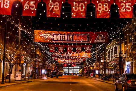 denver colorado: DENVER COLORADO  USA - January 10, 2015: Special light and sign display of NFL Team Denver Broncos United in Orange campaign for 2015 NFL Playoffs January 10, 2015 in Denver, Colorado