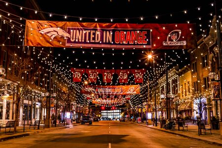 DENVER COLORADO  USA - January 10, 2015: Special light and sign display of NFL Team Denver Broncos United in Orange campaign for 2015 NFL Playoffs January 10, 2015 in Denver, Colorado