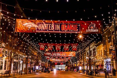 denver co: DENVER COLORADO  USA - January 10, 2015: Special light and sign display of NFL Team Denver Broncos United in Orange campaign for 2015 NFL Playoffs January 10, 2015 in Denver, Colorado