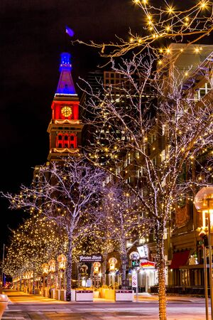 denver 16th street mall: DENVER COLORADO  USA - January 11, 2015, Special light display along Denvers 16th Street Mall with historic landmark Daniel Fisher Tower lit NFL Bronco orange and blue lights January 11, 2015 in Denver, Colorado