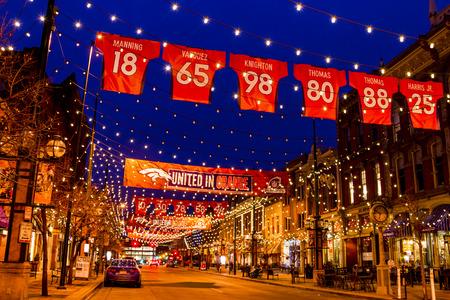 denver colorado: DENVER COLORADO  USA - January 11, 2015: Special light and sign display of NFL Team Denver Broncos United in Orange campaign for 2015 NFL Playoffs January 11, 2015 in Denver, Colorado