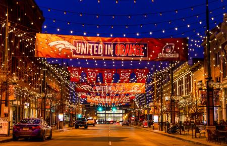 denver co: DENVER COLORADO  USA - January 11, 2015: Special light and sign display of NFL Team Denver Broncos United in Orange campaign for 2015 NFL Playoffs January 11, 2015 in Denver, Colorado