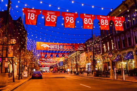DENVER COLORADO  USA - January 11, 2015: Special light and sign display of NFL Team Denver Broncos United in Orange campaign for 2015 NFL Playoffs January 11, 2015 in Denver, Colorado