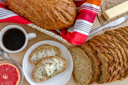 whole grains: Whole grains and seeds fresh baked bread with herb butter, grapefruit and cup of coffee from above