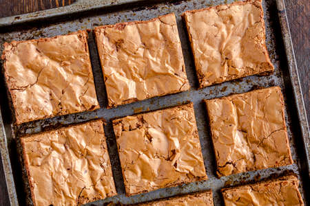 semisweet: Close up of homemade double chocolate chunk brownies sitting on metal baking pan Stock Photo