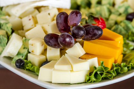 catered: Tray of assorted fruit and cheese at catered event Stock Photo