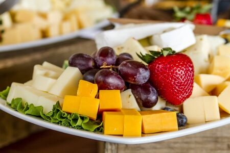 Tray of assorted fruit and cheese at catered event Stock Photo