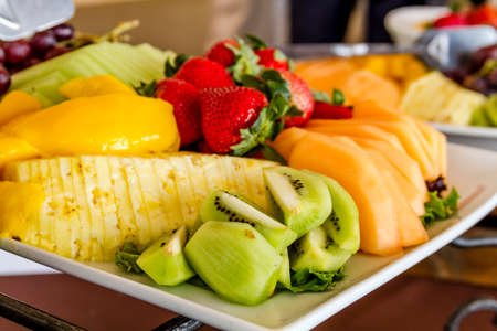 catered: Tray of assorted fruit at catered event