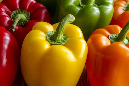 bell peppers: Close up of tops of assorted colorful bell peppers