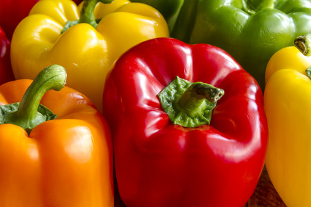 Close up of tops of assorted colorful bell peppers