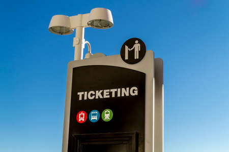 ticketing: Train depot ticketing signs in early morning sunlight