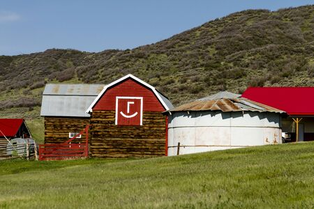 red barn: Red barn in mountain ranch setting with white emoticon symbol on side of barn