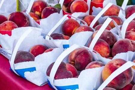 peach: bags of fresh organic Colorado yellow peaches Stock Photo