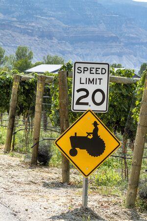 wine road: Farmer crossing sign along road in wine vineyard Stock Photo