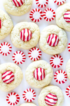 kiss biscuits: Homemade candy cane white chocolate cookies on white background with striped candies