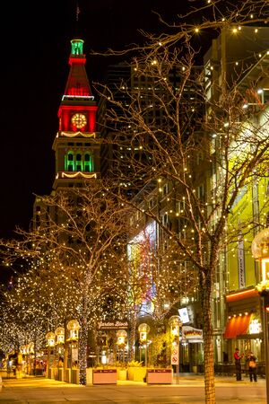 christmas in denver: DENVER COLORADO  USA - December 13, 2015: Holiday light display along Denvers 16th Street Mall with historic landmark Daniel Fisher Tower lit with red and green lights on December 13, 2015 in Denver, Colorado