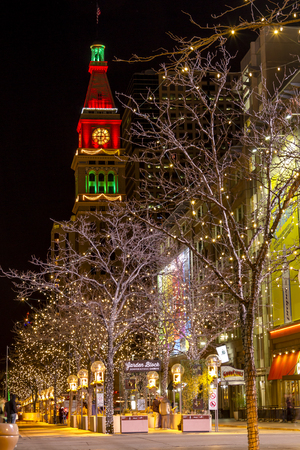 denver 16th street mall: DENVER COLORADO  USA - December 13, 2015: Holiday light display along Denvers 16th Street Mall with historic landmark Daniel Fisher Tower lit with red and green lights on December 13, 2015 in Denver, Colorado