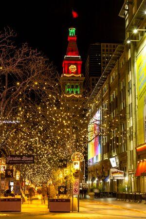 #51147132   DENVER COLORADO USA   December 13, 2015: Holiday Light Display  Along Denvers 16th Street Mall With Historic Landmark Daniel Fisher Tower  Lit ...