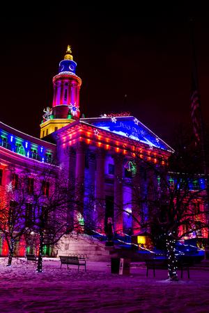 denver at christmas: DENVER COLORADO  USA - November 29, 2015, Special holiday light display of landmark or Denver City and County Building November 29, 2015 in Denver, Colorado Editorial