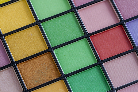 Colorful palette filled with eye shadow shades for eyes