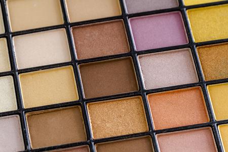 nudes: Close up of pale colorful palette of eye shadow colors Stock Photo