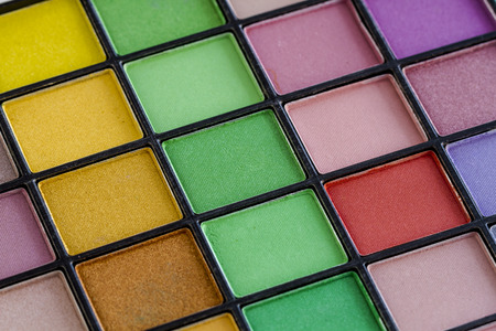 nudes: Close up of bright colorful palette of eye shadow colors