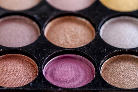 nudes: Close up of pink eye shadow in palette of nude eye shadow shades